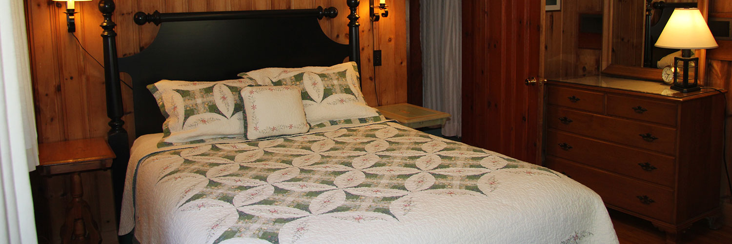 Bedroom with queen bed at Lone Pine
